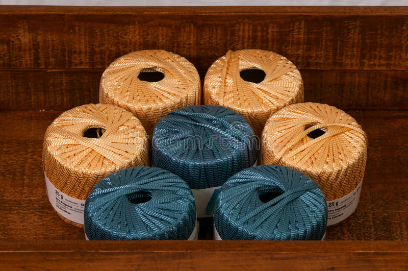 Knitting yarn in a wooden box stock photography