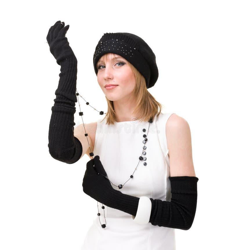 Knitwear. kvinna som slitage ett vinterlock royaltyfri foto