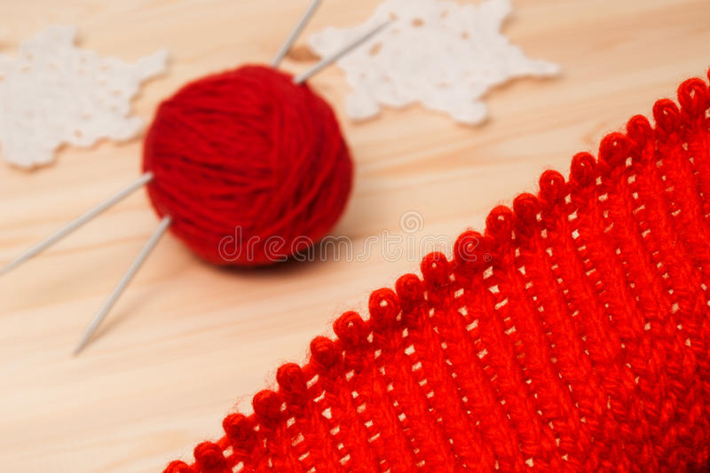 Knitwear, yarn and knitted decoration snowflakes stock photo