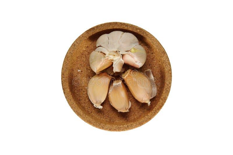 Knoblauch und Schalen stockbild