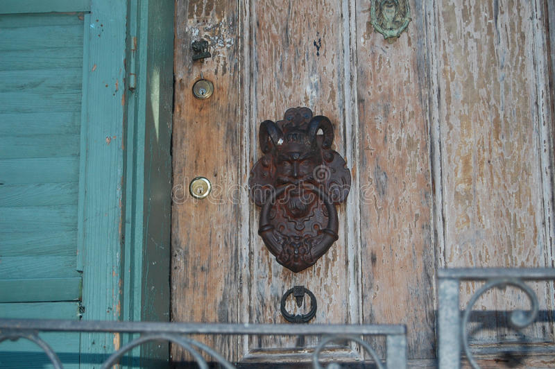 Knock, knock--Who's there?. Devilish door knocker on an old house in New Orleans' French Quarter royalty free stock photos