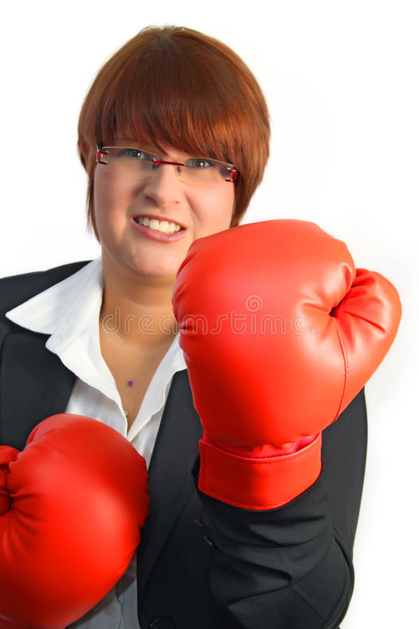 Knock out. Businesswoman ready to knock out some competitors stock images