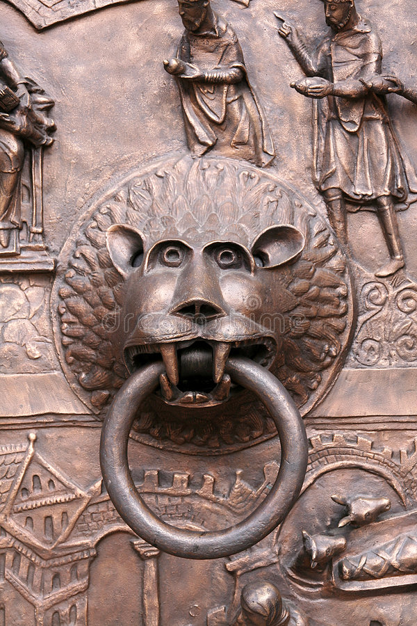 Knocker. Lionhead knocker on the cloistral gate stock image