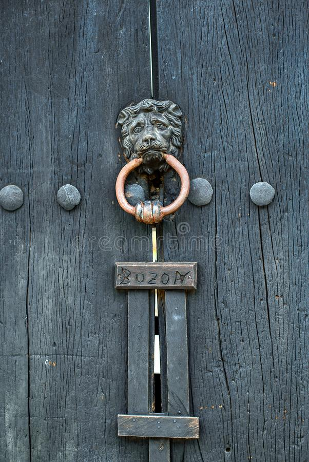 Knocker with the face of a sad lion stock photos