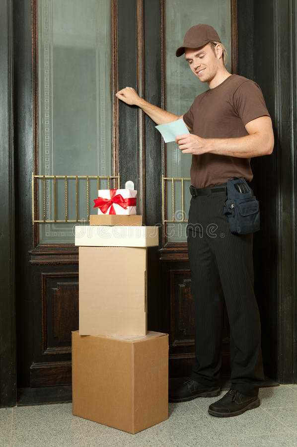 Knocking on the door. Deliveryman knocking on the door royalty free stock photography