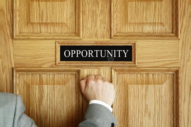 Knocking on the door to opportunity. Businessman knocking on a door to Opportunity office concept for aspirations, progress meeting or promotion stock photos
