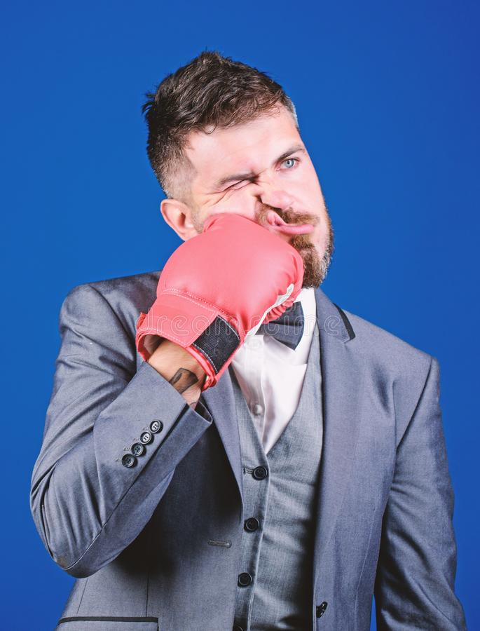 Knockout and energy. Fight. Business and sport success. powerful man boxer ready for corporate battle. businessman in. Suit and bow tie. bearded man in boxing royalty free stock image