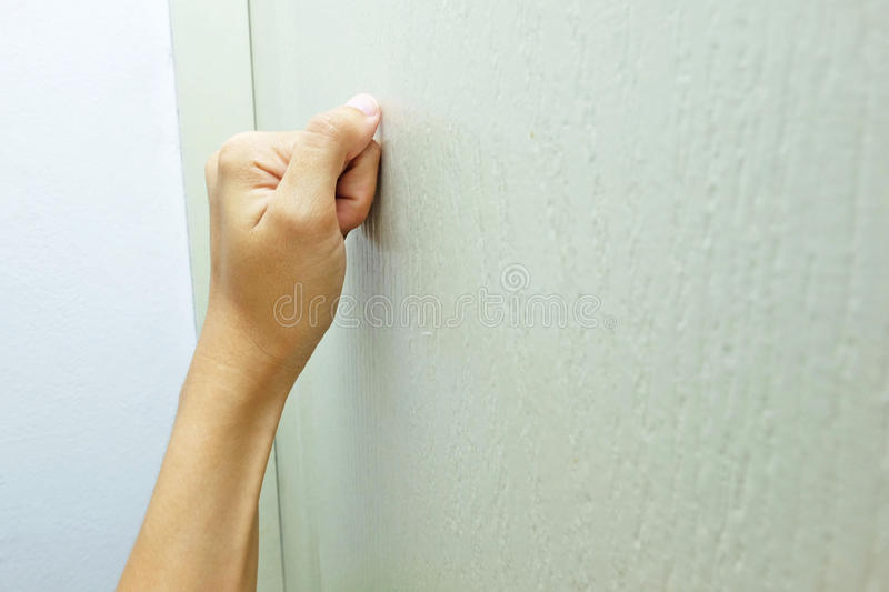 Knocks on the door. The hand which Knocks on the door stock images