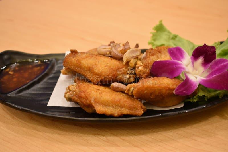 Knoflook smakelijk Fried Chicken Wings Very stock fotografie