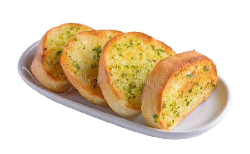 Knoflookbrood in witte plaat stock fotografie
