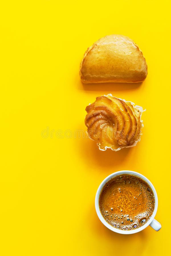 Knolling composition traditional Italian pastry cassatella sweet ravioli with ricotta filling zeppole cup of freshly brewed coffee royalty free stock photo
