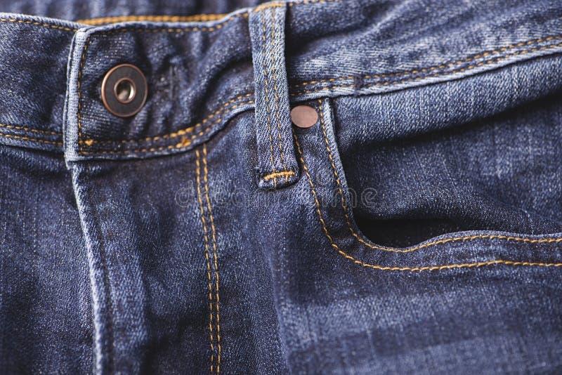 Knoop op een jeansvlieg stock foto's