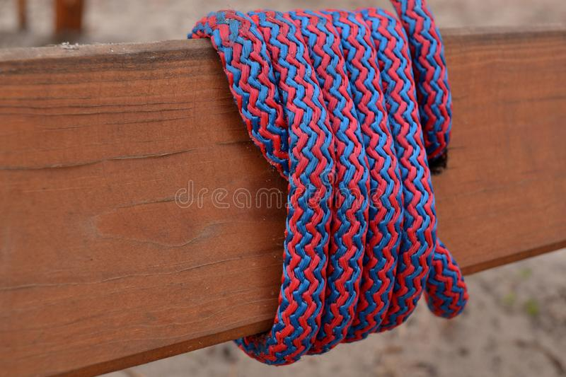 Knot on a colorful rope. Tools for climbing. stock images
