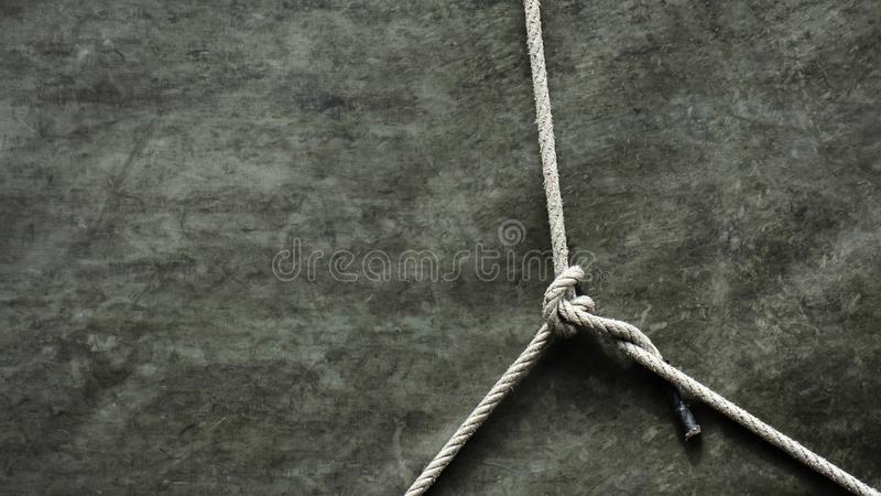 Knot of a rope at old canvas royalty free stock photos