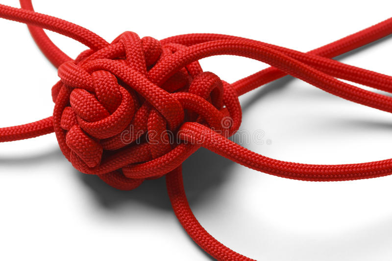 Knot Tangle. Red Rope in A Tangled Mess Isolated on White Background royalty free stock photos
