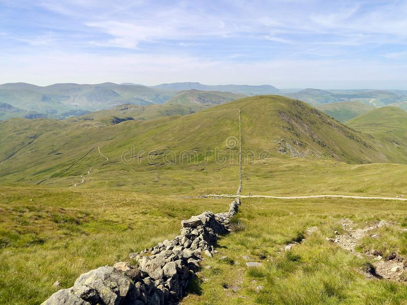 By wall on side of The Knott with Rest Dodd over there, Lake District stock images