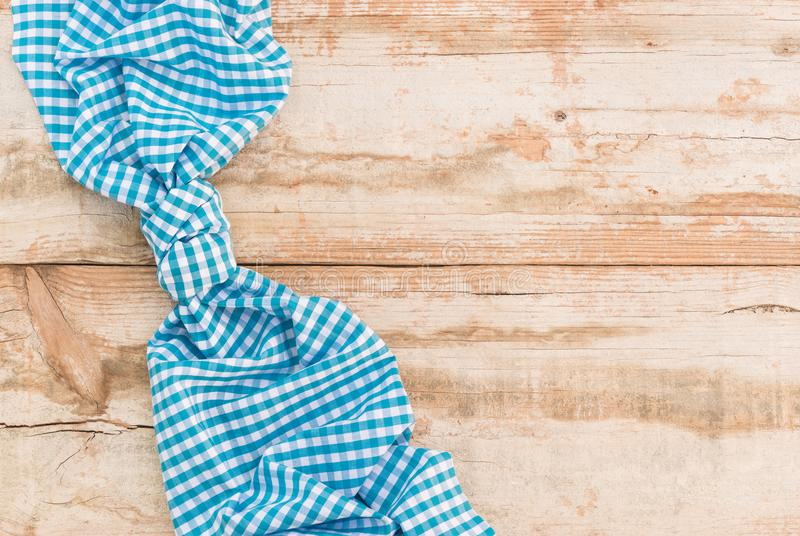 Vintage wooden table background with blue checked tablecloth royalty free stock images