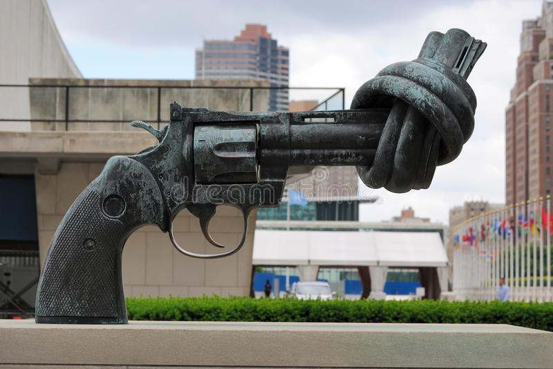 Knotted Gun (Non Violence). Non Violence is a global series of sculptures by Carl Fredrik Reuterswärd, this one at the United Nations in New York City royalty free stock photo