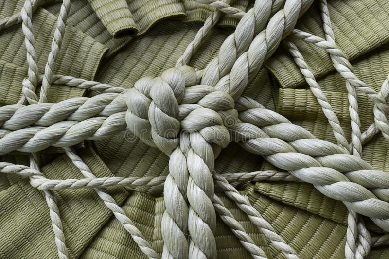 Knotted rope on a sake barrel stock photo