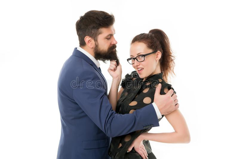 Knowing his dirty secrets. She knows how achieve success. Colleagues man with beard and pretty woman flirting. Office. Knowing his dirty secrets. She knows how royalty free stock image