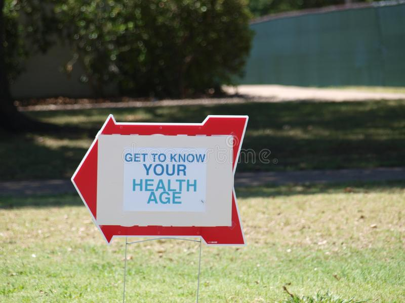 Knowing Your Health Age Is Critical. A planned Health Expo this past weekend saw a large turnout of participants. Signs like this pointed the way from a major royalty free stock images