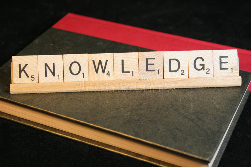 Knowledge. The word KNOWLEDGE on a textbook stock images