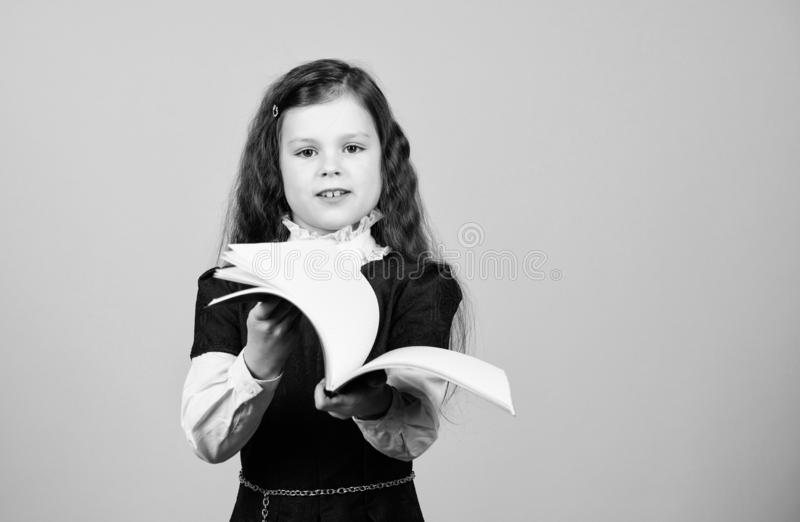 Knowledge day. Serious about studying. Schoolgirl adorable child. Childhood and upbringing. Knowledge and information. Small kid study. School life. Education royalty free stock photos