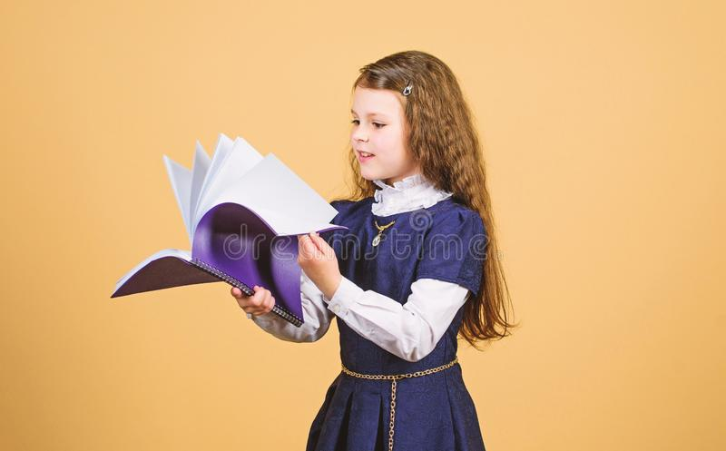 Knowledge and education. Back to school. serious small girl wants to be teacher. notebook for diary notes. study lesson. Small girl with paper folder. Reading stock photography