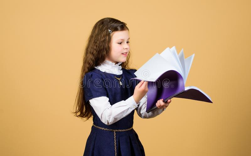 Knowledge and education. Back to school. serious small girl wants to be teacher. notebook for diary notes. study lesson. Small girl with paper folder. Reading royalty free stock photos
