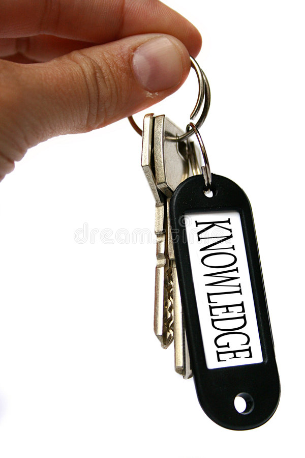 Knowledge keys. An image of a keychain and hand with the word knowledge stock photos