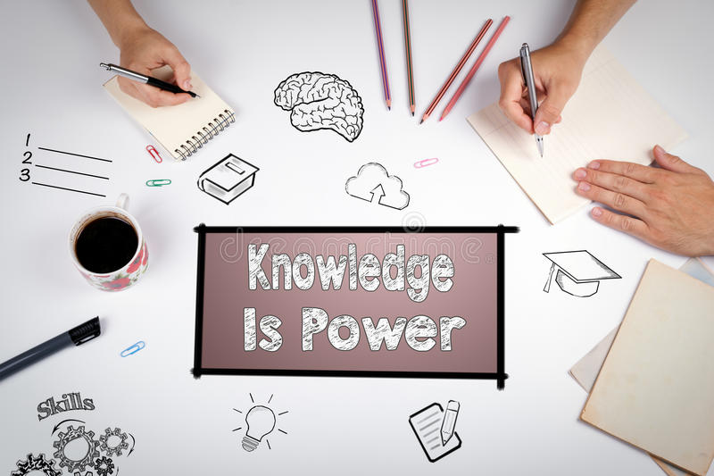Knowledge Is Power Concept. The meeting at the white office table stock photo