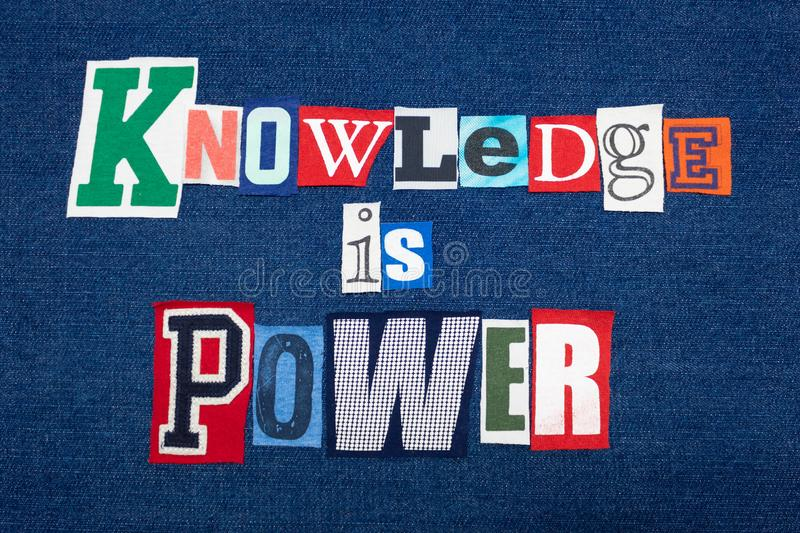 KNOWLEDGE IS POWER text word collage, colorful fabric on blue denim, positive education concept royalty free stock photography