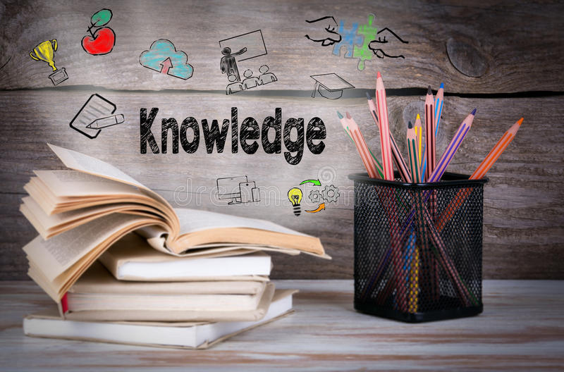 Knowledge. Stack of books and pencils on the wooden table. Stack of books and pencils on the wooden table royalty free stock photos