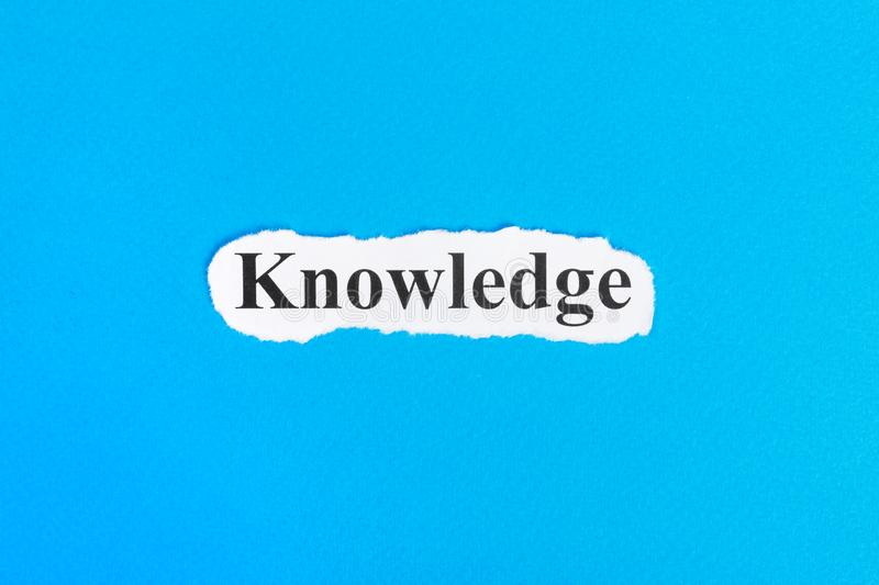 Knowledge text on paper. Word knowledge on torn paper. Concept Image.  royalty free stock photo