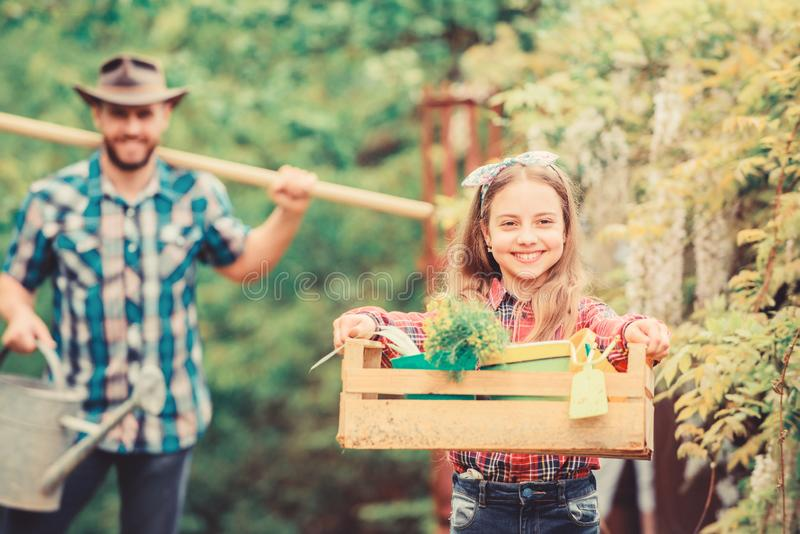 She knows everything about flowers. spring village country. father and daughter on ranch. little girl and happy man dad stock images