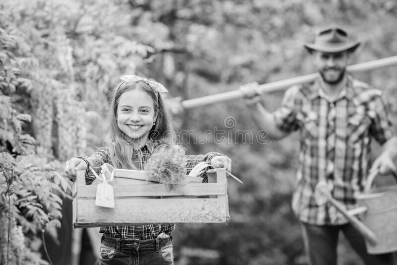 She knows everything about flowers. spring village country. father and daughter on ranch. little girl and happy man dad stock photo