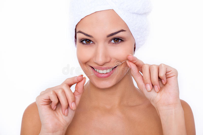 She knows the importance of flossing. royalty free stock photos