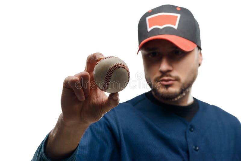 Knuckleball i kannas händer arkivfoton