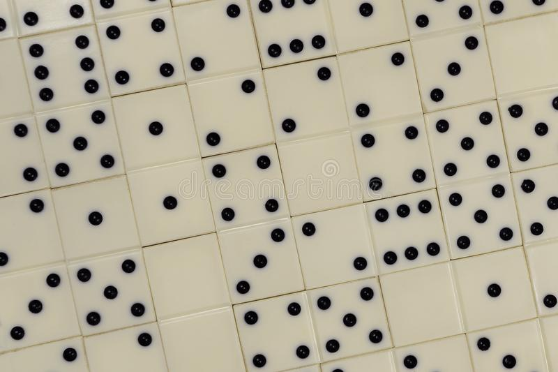 Dominoes stacked together on the table stock image