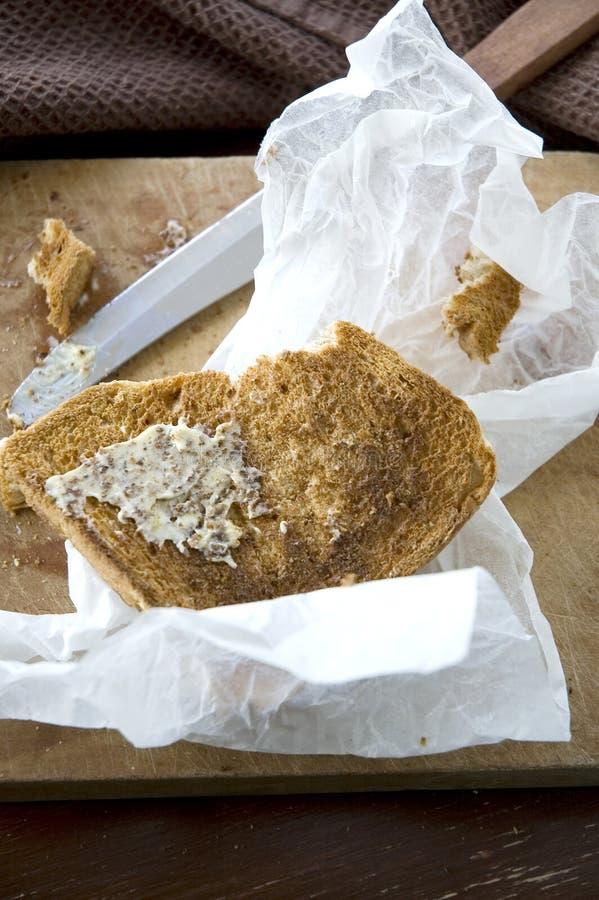 Knusperiges geröstet mit Butter stockbilder
