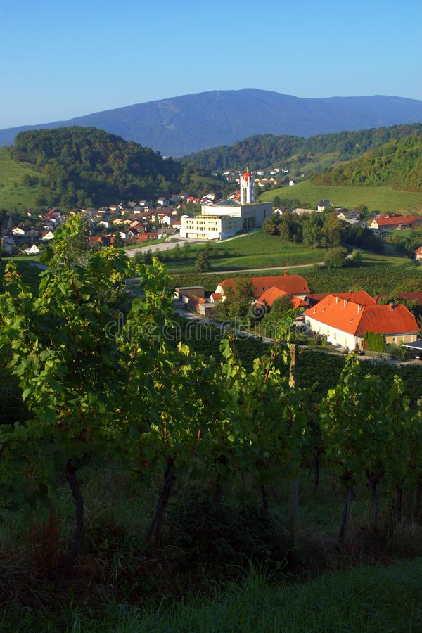 Košaki, Maribor, Slovenia. City suburb Košaki near Maribor, Slovenia with modern church, vineyards and Pohorje mountain in the background in late summer stock photography