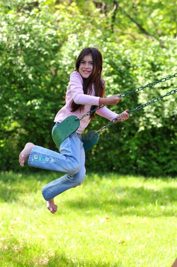 kołyszący młodych dziewcząt fotografia royalty free