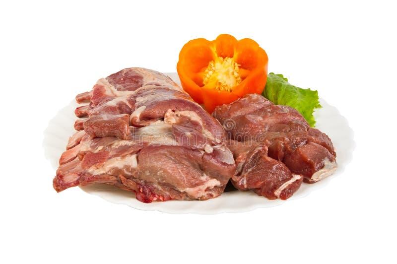 Kończący produkty robić dzikiego knura mięso na talerzu, odosobniony obraz royalty free
