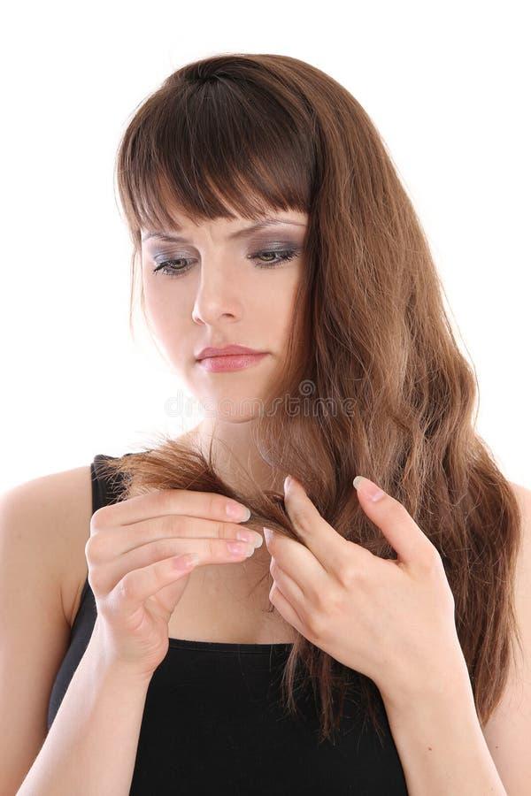 kończyć dziewczyna włosy jej spojrzenia rozszczepiają obrazy stock