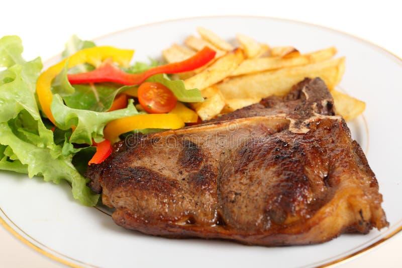 kości posiłku niecki osmalony stek t fotografia stock