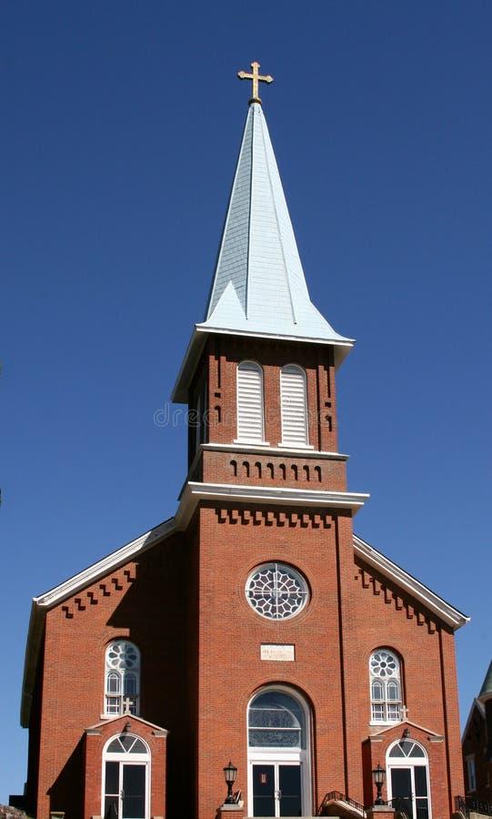 kościelnemu przeciwko błękitnemu wieży obrazy stock