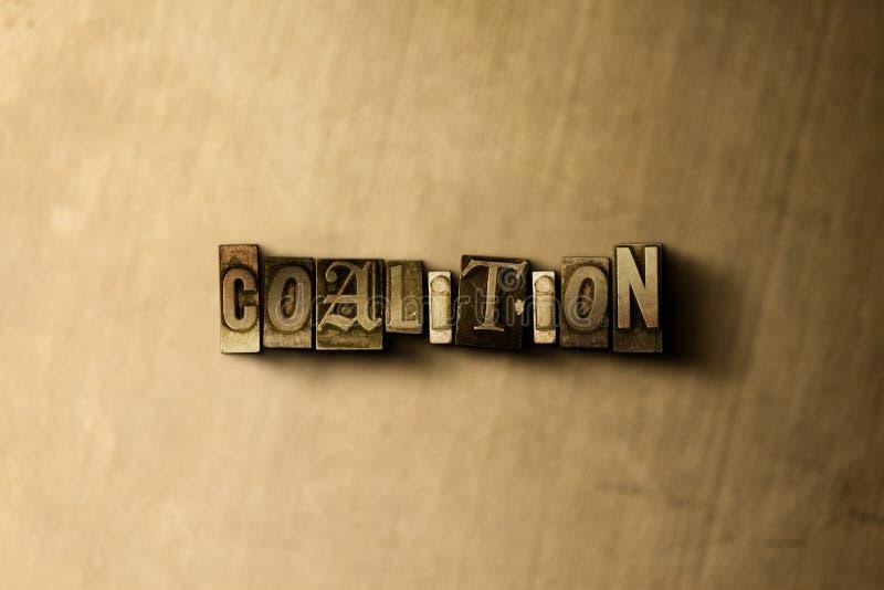 KOALITION - Nahaufnahme des grungy Weinlese gesetzten Wortes auf Metallhintergrund lizenzfreies stockbild