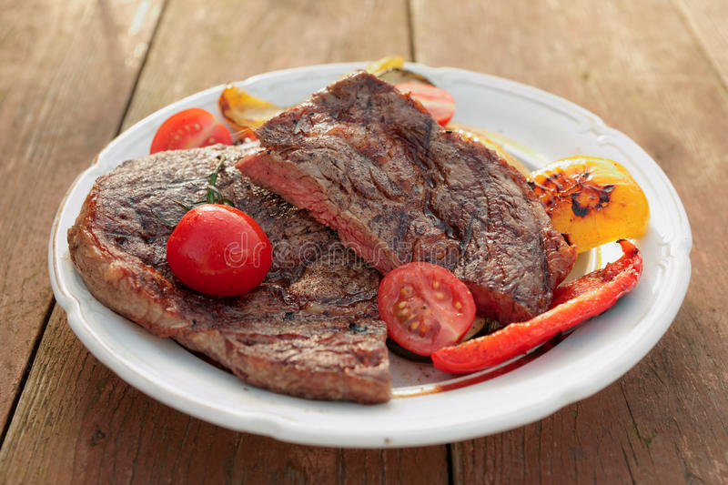 Kobe beef ribeye steak with grilled vegetables. On old table royalty free stock photos