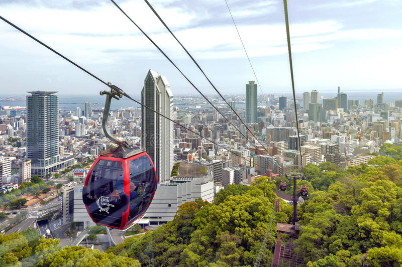 Kobe cityscape and skyscraper seen from ropeway to Nunobiki Herb Garden on Mount Rokko in Kobe, Japan. Kobe, Japan - April 2016: Kobe cityscape and skyscraper stock image