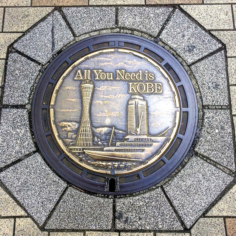 Close up picture of a beautifully decorated Manhole of Kobe City, Japan. Kobe, Hyogo, Japan - 29th October 2018 : Close up picture of a beautifully decorated royalty free stock image